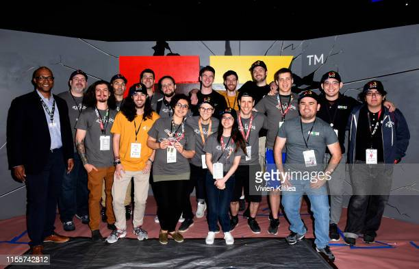 Stanley PierreLouis poses with the winners of the E3 College Game Competition from Canada The United States and Mexico during E3 2019 at the Los...