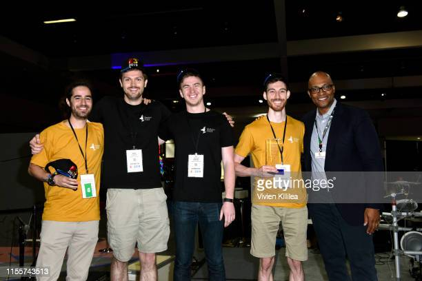 Stanley PierreLouis poses with winners of the E3 College Game Competition from Drexel University pose onstage during E3 2019 at the Los Angeles...