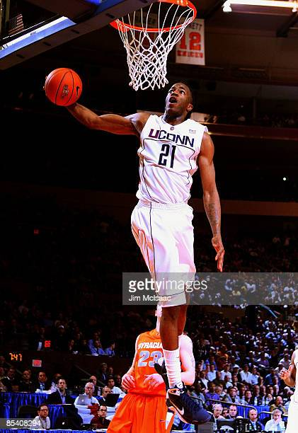 Stanley Robinson of the Connecticut Huskies dunks the ball against the Syracuse Orange during the quarterfinals of the Big East Tournament at Madison...