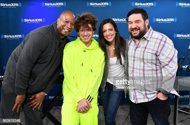 Stanley T Charlie Puth Nicole Ryan and Ryan Samson pose for photo at Hits 1 at SiriusXM Studios on March 16 2018 in New York City