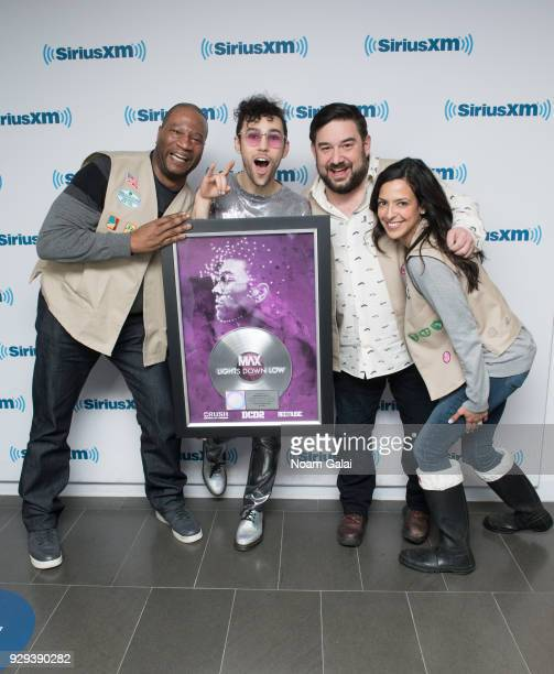 Stanley T MAX Ryan Sampson and Nicole Ryan pose for a photo with MAX's Platinum record plaque at SiriusXM Studios on March 8 2018 in New York City