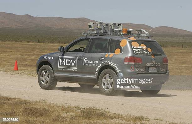Stanley the Stanford Racing Team's entry into the 2005 DARPA Grand Challenge drives with no one aboard through a desert course Supported by early...