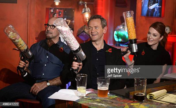 Stanley Tucci Alexander Armstrong and Julianne Moore during a live broadcast of 'TFI Friday' at the Cochrane Theatre on November 6 2015 in London...