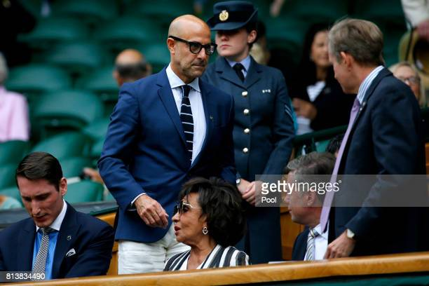 Stanley Tucci and Dame Shirley Bassey look on from the centre court royal box on day ten of the Wimbledon Lawn Tennis Championships at the All...