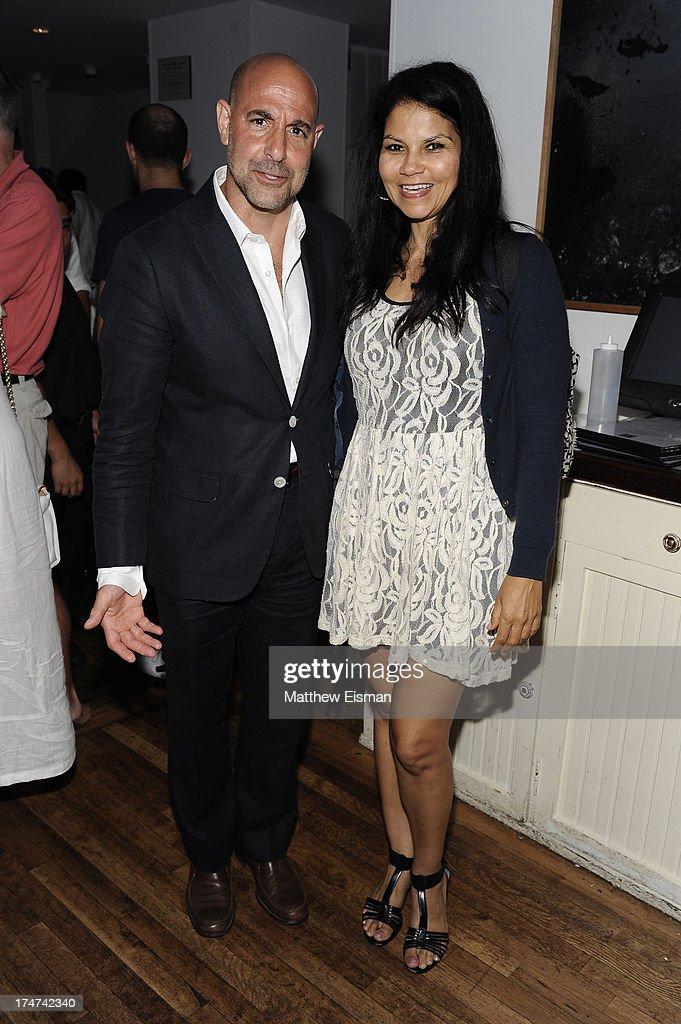 Stanley Tucci (L) and Juliette Fairley attend 'Percy Jackson: Sea Of Monsters' Hamptons Premiere afterparty at 75 Main Street on July 28, 2013 in Southampton, New York.