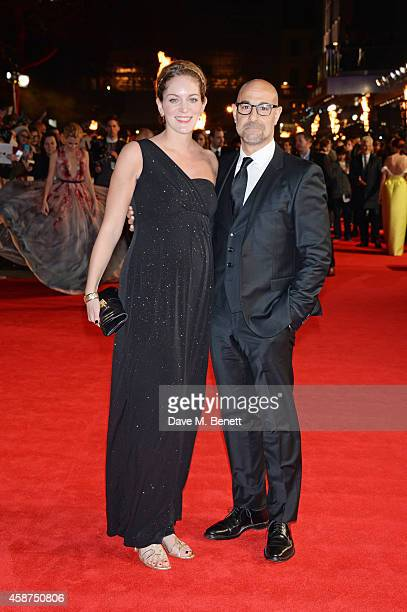 Stanley Tucci and wife Felicity Blunt attend the World Premiere of The Hunger Games Mockingjay Part 1 at Odeon Leicester Square on November 10 2014...