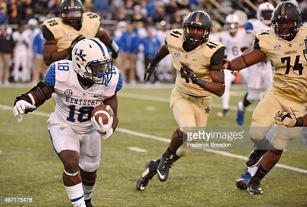 Stanley Williams of the Kentucky Wildcats is pursued by Zach Cunningham and Jay Woods of the Vanderbilt Commodores during the first half at...