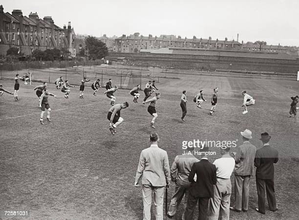 Stanley Wilson chief instructor of the Carnegie Physical Traning College Leeds working with the Arsenal footballers at Tufnell Park while their...