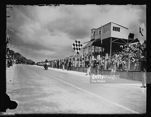 Stanley Woods wins the Junior TT Race on the Isle of Man on his Velocette motorcycle 12th June 1939