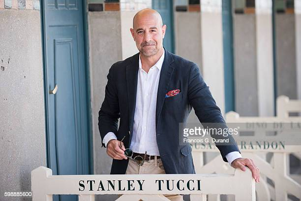Stanly Tucci poses for photographers after he unveiled his cabin along the Promenade des Planches during the 42nd Deauville American Film Festival on...