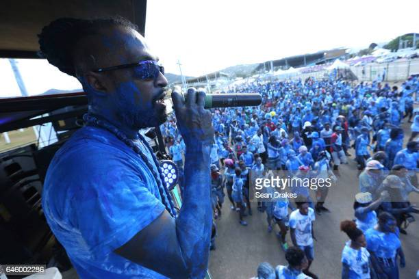 Stanton Kewley of the Rapso music band 3canal takes part in J'ouvert during the 20th anniversary celebration of their song Blue as part of Trinidad...
