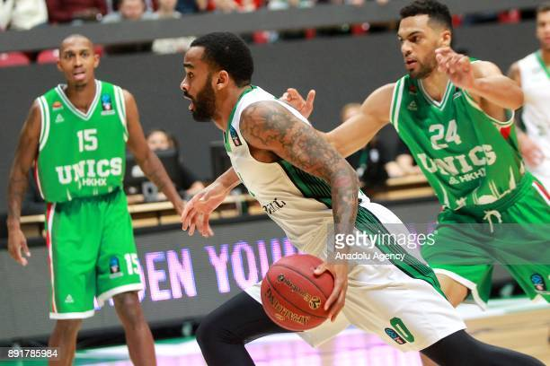 Stanton Kidd of Darussafaka Dogus in action against Jamar Smith and Trent Lokett of UNICS Kazan during the EuroCup basketball match between UNICS...