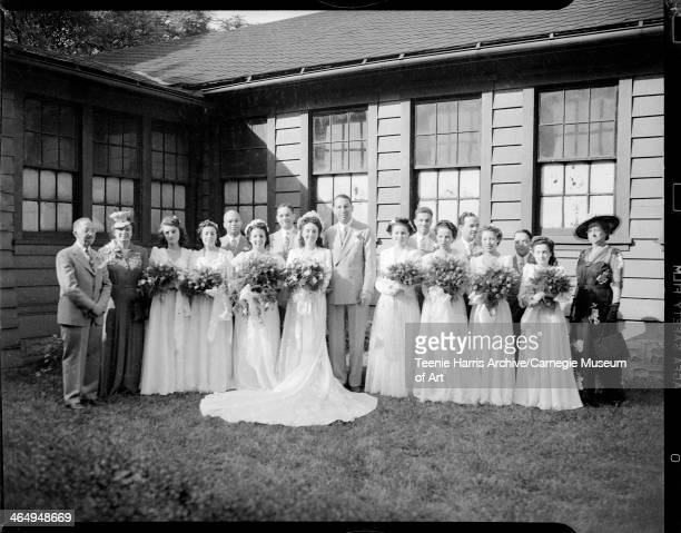 StantonTaylor wedding party posed on grass Pittsburgh Pennsylvania July 1 1944 First row from left John Stanton Mrs Stanton Alice Batch Jean Nelson...