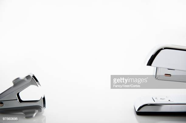 Stapler and staple remover in confrontation