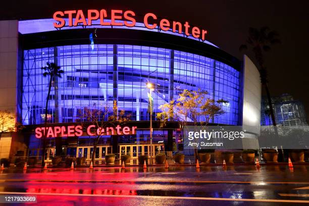 Staples Center is illuminated in blue lights during the coronavirus pandemic on April 09, 2020 in Los Angeles, United States. Landmarks and buildings...