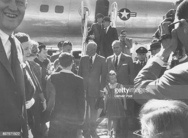 Stapleton Greeting Scene President Eisenhower poses with Gov Steve McNichols at the foot of the landing ramp of presidential plane Those in the...