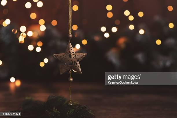 star abstract decoration lights, gold sparkles, shine blurred background - christmas wallpaper stock pictures, royalty-free photos & images