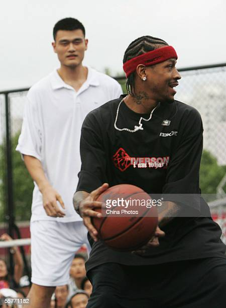 NBA star Allen Iverson of USA and Yao Ming of China play basketball with fans during an event at Shanghai Stadium on September 25 2005 in Shanghai...