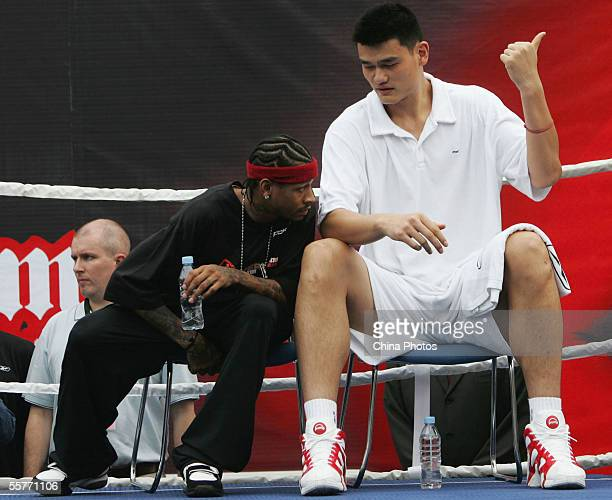 NBA star Allen Iverson of USA talks with Yao Ming of China during an event at Shanghai Stadium on September 25 2005 in Shanghai China Philadelphia...