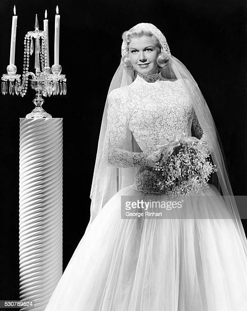 WB star and radio lark of the Bob Hope show in a bride's outfit of lace and tulle