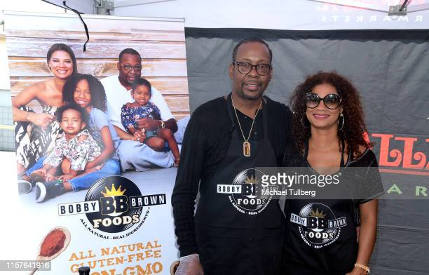 B star Bobby Brown and wife Alicia Etheredge attend a launch event for his line of sauces and spices Bobby Brown Foods at Vallarta Supermarket on...