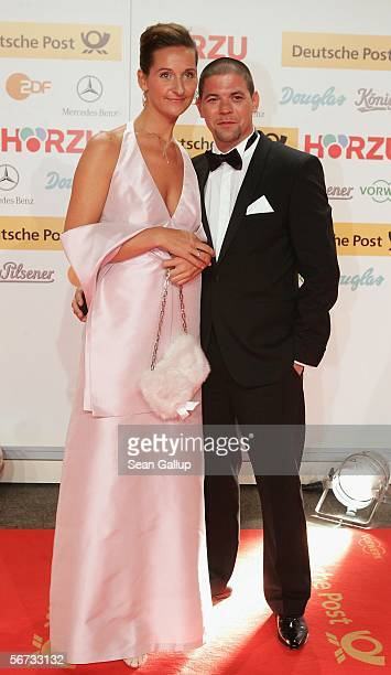 Star chef Tim Maelzer and friend Nina Heik arrive at the Goldene Kamera Awards at the Axel Springer building February 2 2006 in Berlin Germany