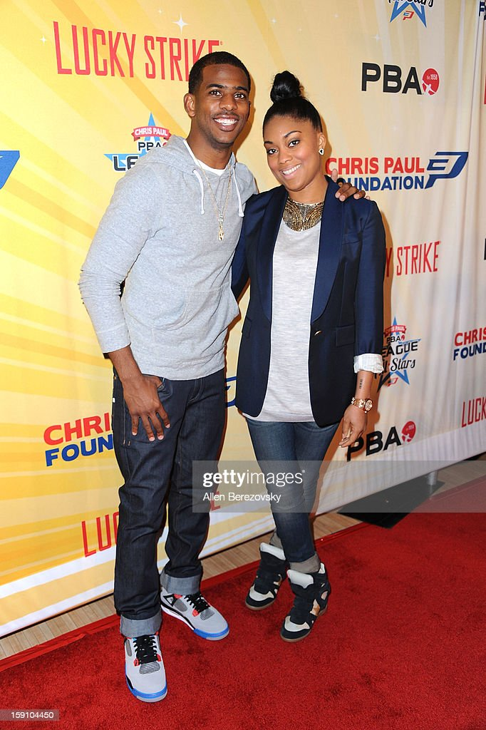 NBA star Chris Paul and wife Jada Crawley arrive at the 5th annual Chris Paul PBA All-Stars Invitational hosted by LA Clippers star guard Chris Paul at Lucky Strike Lanes at L.A. Live on January 7, 2013 in Los Angeles, California.