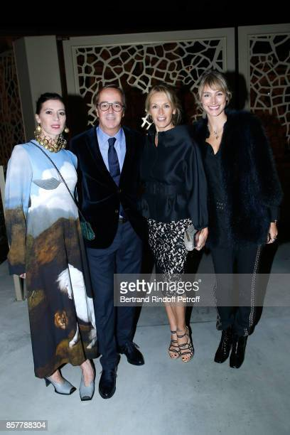 Star Dancer MarieAgnes Gillot CEO of Louis Roederer Frederic Rouzaud Estelle Lefebure and actress Pauline Lefevre attend the 'Diner Surrealiste' to...