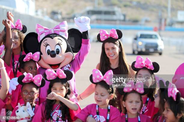 RACERS NASCAR star Danica Patrick and Minnie Mouse in her new racing suit surprised girls from the Boys Girls Clubs of Metro Phoenix at the Phoenix...