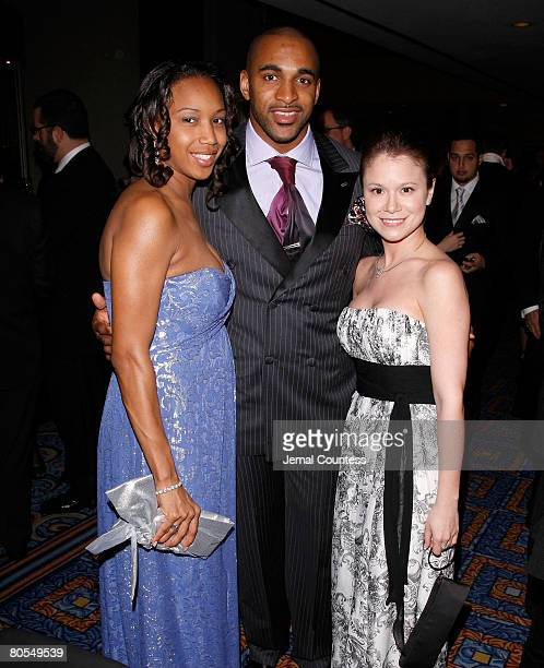 Star David Tyree with wife Leilah Tyree and Jacqueline J Gonzalez Executive Director of the New York Emmy's poses for a picture during the cocktail...