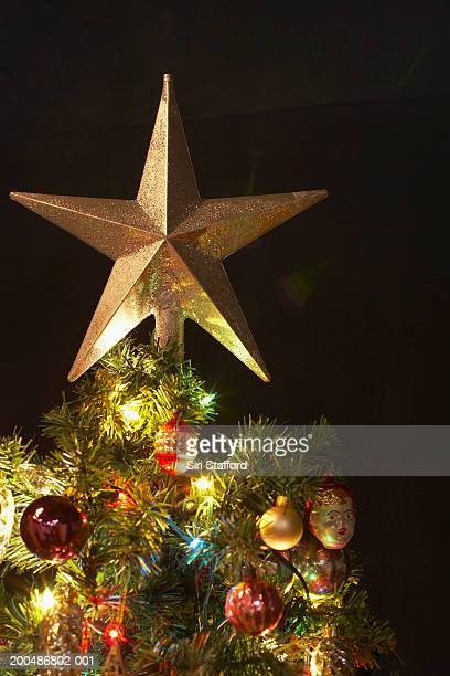 Star decoration atop Christmas tree