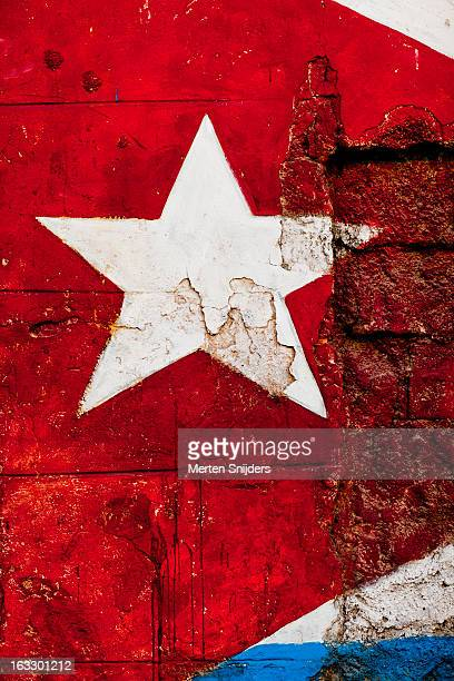 star detail of cuban flag on wall - cuban flag stock pictures, royalty-free photos & images