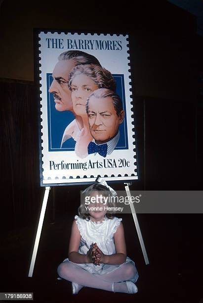 'ET' star Drew Barrymore poses for a photograph with new Barrymore stamp being issued June 8 1982 in New York City