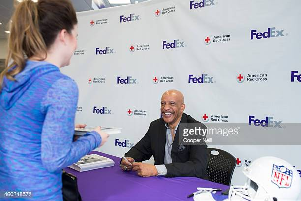 Star Drew Pearson teams up with FedEx Office to help support the American Red Cross as part of Pack Ship Give on December 10 2014 in Dallas Texas