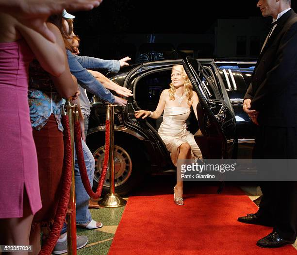 star emerging from limo at premiere - film premiere stock pictures, royalty-free photos & images
