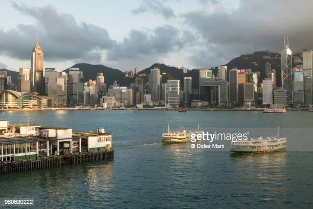 Star Ferries crossing the Victoria harbor between the Tsim Sha Tsui pier and Hong Kong island Central in Hong Kong