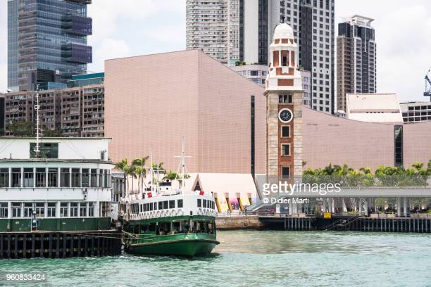 A star ferry at the Tsim Sha Tsui pier in Kowloon by the Victoria harbor in Hong Kong