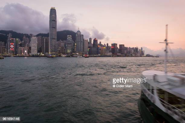 A Star ferry crossing the Victoria harbor toward Hong Kong island Central district