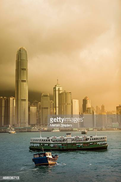 star ferry during sunrise - merten snijders stock-fotos und bilder