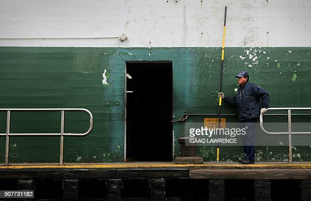 A Star Ferry employee waits to assist the mooring of the ferry as it comes into dock at the Tsim Sha Tsui side of Hong Kong on January 31 2016 The...
