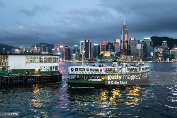 star ferry in hong kong at night, kowloon side - star ferry stock photos and pictures
