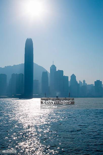 star ferry in hong kong harbour and skyline - star ferry stock pictures, royalty-free photos & images