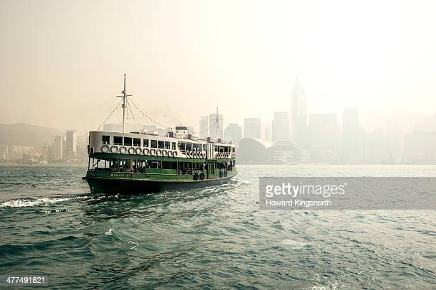 star ferry in the mist hong kong harbour - fähre stock-fotos und bilder