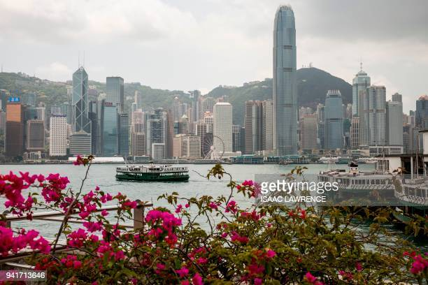 A Star Ferry makes a crossing of Victoria Harbour from the Tsim Sha Tsui district to Hong Kong island on April 4 2018 / AFP PHOTO / ISAAC LAWRENCE