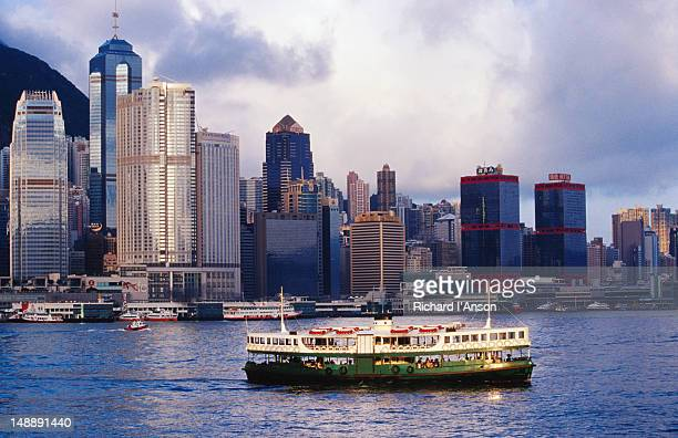star ferry on victoria harbour with hong kong skyline (central and sheung wan) in background. - star ferry stock pictures, royalty-free photos & images
