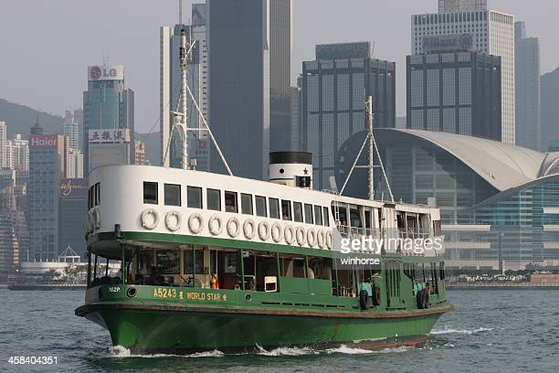 star ferry with hong kong skyline - star ferry stock photos and pictures