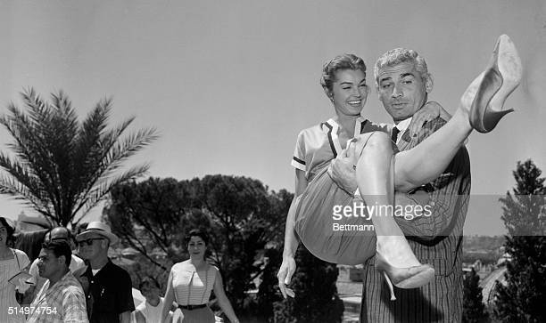 Star is born as actress Esther Williams gets a lift from the strong arms actor Jeff Chandler at the Pincio Terrace in the famed Borghese Gardens of...