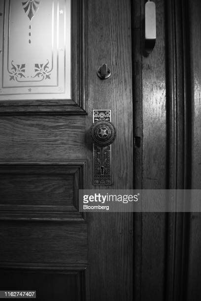 Image has been shot in black and white. Color version not available.) A star is seen on a doorknob at the Texas State Capitol in Austin, Texas, U.S.,...