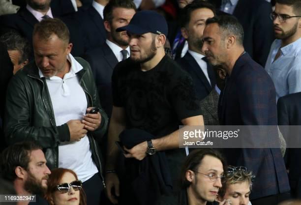 MMA star Khabib Nurmagomedov of Russia Youri Djorkaeff attend the UEFA Champions League group A match between Paris SaintGermain and Real Madrid at...
