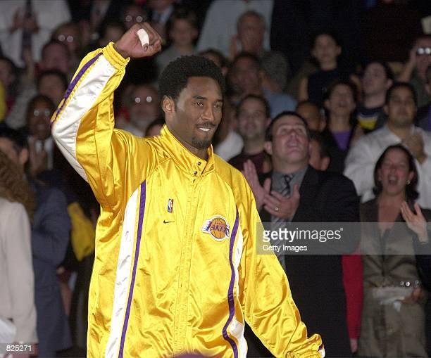 NBA star Kobe Bryant acknowledges the fans before the Los Angeles Lakers played the Utah Jazz November 1 2000 in Los Angeles Bryant and his teammates...